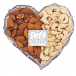 Dry Nuts On Heart Shaped Plastic Tray