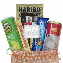 Chocolates And Snacks In Beautiful Pouch (9 items)