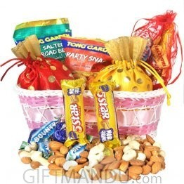 Basket Full Of Dry Nuts, Snacks And Chocolates