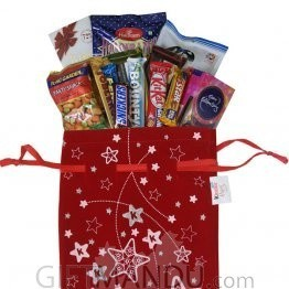Snacks And Chocolate In Christmas Bag