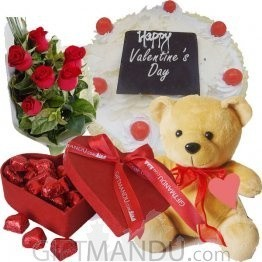 gift pack with flowers, teddy bear, chocolate