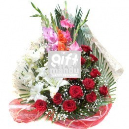 Elegant basket of beautiful romantic red roses with lily flowers