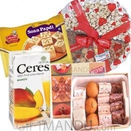 Assorted Sweets, Dry Nuts Tray, Fruit Juice and Soan Papdi
