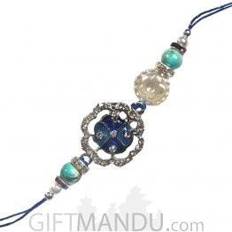 Stone Dubbed Blue Color Kanhaiya Rakhi