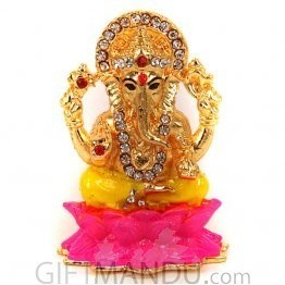Golden Metal with Stone Studded Lord Ganesh Sitting On Lotus