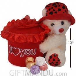 Lovely Teddy Holding A Red Flowery Box Containing Chocolates